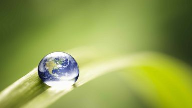 Earth in a water drop on top of a leave